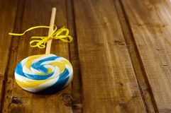 Lollipop on a wooden table Royalty Free Stock Images