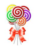 Lollipops με την κόκκινη κορδέλλα Στοκ Εικόνες