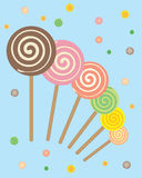 Lollipops abstract. Abstract illustration of lollipops with a swirly design on a bright blue background Royalty Free Stock Photography