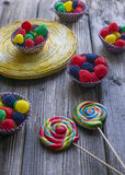 Lollipops and assorted jellies. Sweet and colorfull Lollipops and jellies royalty free stock images
