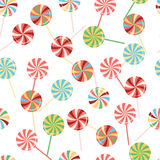 Lollipops background collection. Colorful candy on stick with twisted design. Sweets pattern. Seamless color pattern with round sweets. Lollipops set. Colorful royalty free illustration