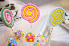 Lollipops on blurry background. Colored lollipops on a blurry background among other sweets Royalty Free Stock Photo