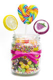 Lollipops and candies in jar Stock Photos