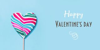 Lollipops candy as heart on blue. Valentine day concept. Lollipops candy as heart with wishes on blue. Valentine day minimal concept stock image