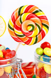 Lollipops, candy and chewing gum in the jar Royalty Free Stock Images