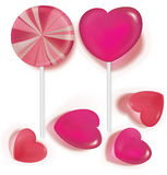 Lollipops  and candy heart shaped on white Royalty Free Stock Image