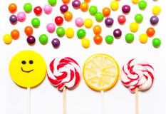Lollipops, candy smile on, scattered round pills Stock Images