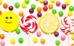 Lollipops, candy smile on, scattered round pills Royalty Free Stock Images
