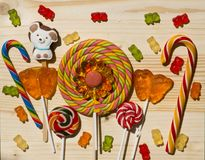 Lollipops cane on a wooden surface background Stock Photo