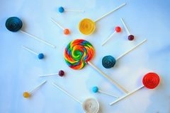 Lollipops on clouds background  with paper lolly pops Royalty Free Stock Photography