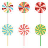Lollipops collection. Colorful candy on stick with twisted design. Sign of sweets made in cartoon style Royalty Free Stock Photos