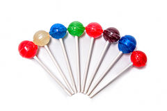 Lollipops Colorful Arranged white background. Colorful arranged half circle lollipops on a pure white background stock photo