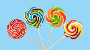 Lollipops. Colorful lollipops isolated on blue background stock photos