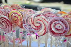 Colorful spiral lollipops for sale. On the market Royalty Free Stock Image