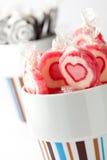Lollipops cor-de-rosa e pretos Imagens de Stock