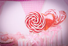 Lollipops in dessert table at girls party Stock Photo