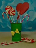 Lollipops in green glass Royalty Free Stock Images