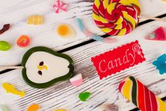 Lollipops and jellies on wooden background. royalty free stock photography