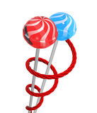Lollipops and liquorice. Two lollipops wrapped with a red liquorice, on a white background Stock Image