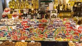 Lollipops and olive oil at La Boqueria market Stock Photos