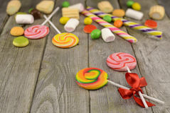 Lollipops with pile of sweets Stock Photos