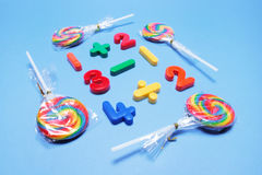 Lollipops with Plastic Numbers Royalty Free Stock Photo