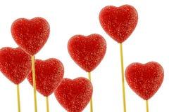Lollipops rojos múltiples del corazón Imágenes de archivo libres de regalías