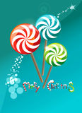 Lollipops round. Three candy and the stylized logo of a happy Christmas Stock Image