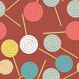 Lollipops seamless pattern. Multicoloured sweets  backgrou. Nd. Caramel candy on a stick Royalty Free Stock Images