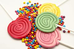 Lollipops. Sprinkes candy and lollipops on white background Stock Photography