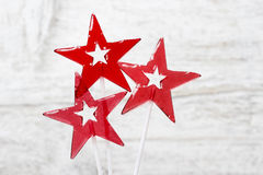 Lollipops in star shape on wooden background Stock Images