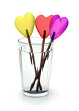 Lollipops in tumbler. Colored candy on wooden sticks Stock Image