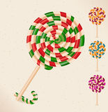 Lollipops- vector. 4 lollipops and a candy cane- vector Stock Image