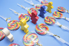 Lollipops with Wooden Figures Royalty Free Stock Photos