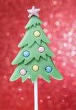 Lolly in de vorm van de Kerstmisboom Stock Foto's