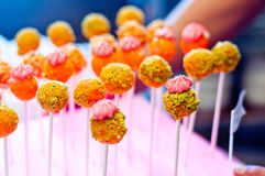 Lolly egg and pistachio for children's parties. Cute lollipops made with egg yolks and flavored with pistachios, sugar, nuts or cocoa Stock Photos