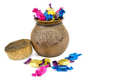 Ceramic lolly jar. With colorful wrapped lollies Royalty Free Stock Image