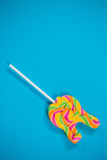 Lollypop on blue background. Close-up of lollypop on blue background Royalty Free Stock Images