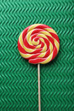 Lollypop candy. Sweet lollypop candy on green background Royalty Free Stock Image