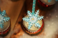 Lollypop closeup on the snow. Decorated with sugar snowflakes Royalty Free Stock Image