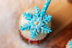 Lollypop closeup on the snow. Decorated with sugar snowflakes Stock Photo