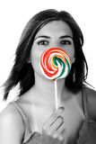 Lollypop Girl. Beautiful woman with a candy in the hands Royalty Free Stock Photography