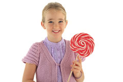 Lollypop girl. Cute girl with red white lollipop in her hand against white background Stock Photos