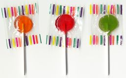 Lollypops on White. Three lollypops isolated on white stock image