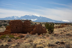 Lomaki Pueblo at Wupatki Monument. Lomaki Pueblo (pretty house), almost 7 miles northwest of Wupatki, was built on the edge of a 3/4-mile-long earth crack in the stock image