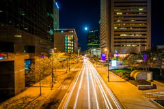 Lombard Street and buildings in downtown at night, in Baltimore, Stock Image