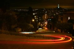 Lombard Street at Night. Car traveling down Lombard Street at Night in San Francisco, California, U.S.A Stock Image