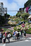 Lombard Street, San Francisco. August 2013 - Tourists at Lombard Street, San Francisco (California) in a sunny day Royalty Free Stock Photos