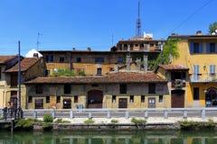 Lombardy - Milan - Naviglio district - Naviglio Grande canal and surrounding buildings - Via Alzaia Naviglio Graande street Stock Images