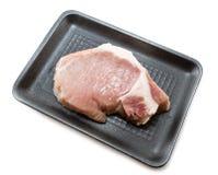 Lombo de carne de porco cru na bandeja de empacotamento Imagens de Stock